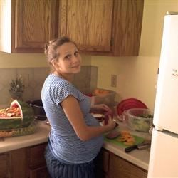 Prego with Troi, cutting up fruit.