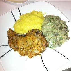 Baked breaded pork chop with mushrooms and polenta