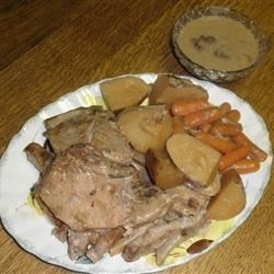 Mushrooms, potatoes, and tender pork chops are slow cooked in a creamy ...