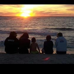 The kids at the beach at sunset!