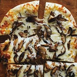 Photo of White Pizza with Mushrooms by Kraft Naturals Shredded Cheese
