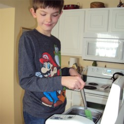 Jared getting the dough ready in the bread maker.