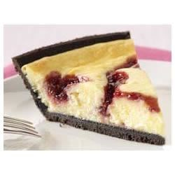 Photo of PHILADELPHIA® 3-STEP® White Chocolate Raspberry Swirl Cheesecake by BAKER'S Chocolate