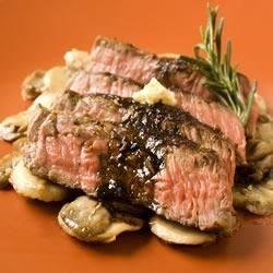 seared sirloin steak with garlic butter photos