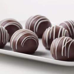 Photo of Triple-Chocolate Cookie Balls by JELL-O