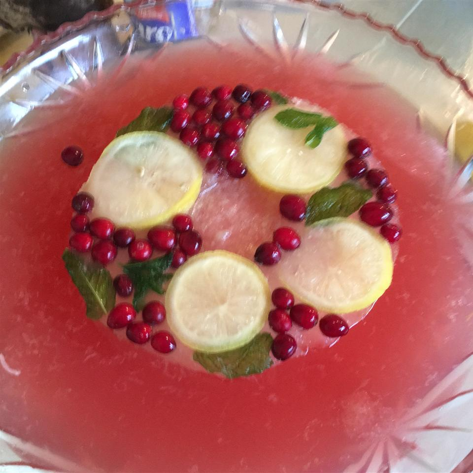 """Looking for Thanksgiving cocktails for a crowd? Here's a terrific low-alcohol punch that's perfect for Thanksgiving gatherings. Mix up a big batch of cranberry juice, pink lemonade, and limeade concentrates, add some white wine, club soda, and champagne, and garnish festively with lemon slices, fresh mint leaves, and for some serious Thanksgiving flair, whole cranberries. """"It's fruity, but not too sweet,"""" says DPRYOR. """"I've added more club soda to make it a little lighter. All ingredients can be adjusted to your own personal taste. Keep the punch cool with ice cubes or an ice ring."""""""