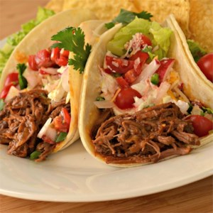 Mexican Shredded Chuck Roast Recipe - Chuck roast simmers in beef broth and guajillo sauce until tender enough to shred for tacos, burritos, tostadas, enchiladas, or taquitos.