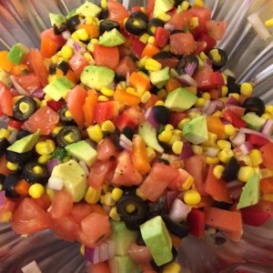 Tomato, Corn and Avocado Salsa Recipe and Video - Tomatoes, corn, and avocado come together in this colorful salsa recipe seasoned with lime juice and onions; serve with your favorite chips.