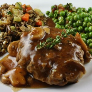 Salisbury Steak with Mushrooms Recipe and Video - Seasoned beef patties are simmered in a homemade mushroom and onion sauce to make this classic, comforting dish. Serve it with potatoes or rice.