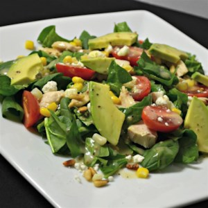 Spinach Salad with Chicken, Avocado, and Goat Cheese Recipe and Video - Use this quick and easy recipe to deliver a great-tasting salad with chicken, avocado, and goat cheese dressing in a homemade vinaigrette.