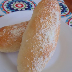 Breadsticks Recipe - Homemade breadsticks brushed with butter and topped with Parmesan cheese are easy to make and taste just like Olive Garden(R) breadsticks.