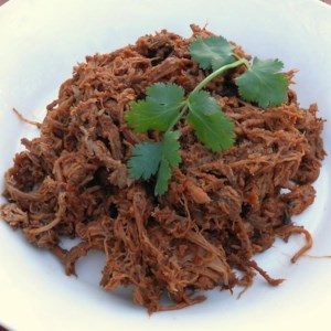 Copycat Chipotle(R) Beef Barbacoa Recipe - Perfect for a taco or burrito dinner, this Mexican-inspired beef barbacoa gets heat and flavor from a sauce made with chipotle peppers, lime juice, and other tasty spices.