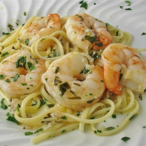 Shrimp Scampi with Pasta Recipe and Video - Shrimp are served with linguine pasta in a white wine-and-butter sauce flecked with fresh parsley for a quick and impressive main dish.