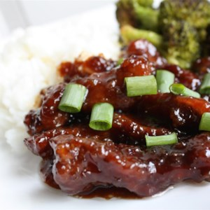 Mongolian Beef and Spring Onions Recipe and Video - Thin-sliced beef flank steak gets a quick fry in hot oil, then is simmered in a sweet soy-based sauce with fresh green onions for a dish that's like eating out at home.