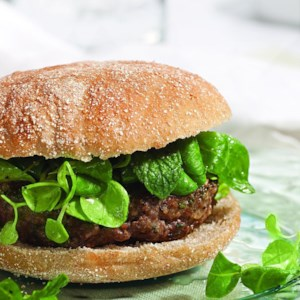 Lamb Burgers Topped with Mache Salad