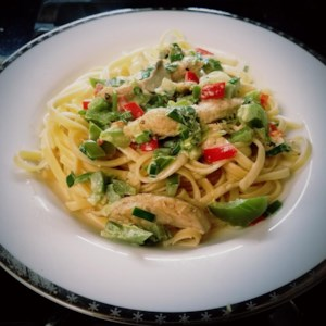 Creamy Cajun Chicken Pasta Recipe and Video - Serve up a spicy dinner for two with this hot and creamy linguini tossed with an eye-opening blend of chicken strips sauteed with Cajun seasoning, colorful bell peppers, mushrooms and onions. Cream, basil, lemon pepper and garlic powder finish the sauce.
