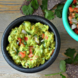 Guacamole Recipe and Video - Cilantro and cayenne give this classic guacamole a tasty kick. Serve it smooth or chunky.