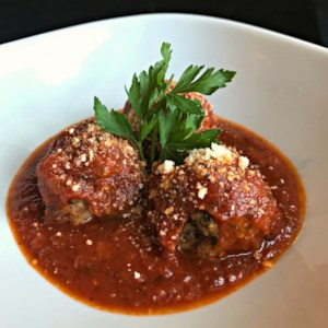 Chef John's Italian Meatballs Recipe and Video - These Italian meatballs use a standard mix of ground beef and ground pork, with added flavor from parsley, garlic, and dried herbs. Bake up a batch, mix them with your favorite spaghetti dish, and dinner is served!
