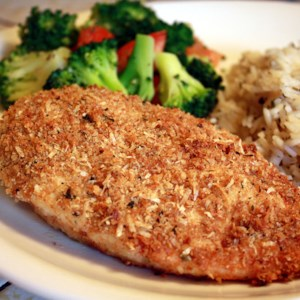 Garlic Chicken Recipe and Video - Submerge chicken in a strong garlic-olive oil infusion, then coat with Parmesan and bread crumbs for a quick and sublime baked chicken.