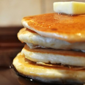 Fluffy Pancakes Recipe and Video - Tall, fluffy pancakes make the best breakfast, especially when there's plenty of butter and syrup. Make it extra special with berries and whipped cream!