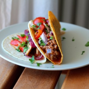Taco Meat Recipe - This simple and fast recipe makes a batch of seasoned ground beef in tomato sauce you can use in tacos or any other Mexican-style favorites.