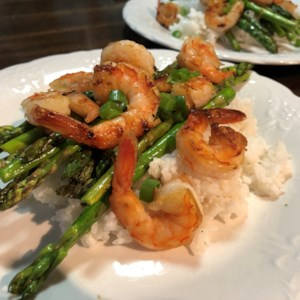 Grilled Teriyaki Prawns with Asparagus and Coconut Rice Recipe and Video - Teriyaki prawns and asparagus are grilled and served on a bed of coconut jasmine rice for a quick and easy, Asian-inspired barbeque dish.