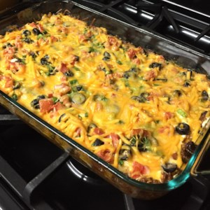 Easy Mexican Casserole Recipe and Video - This Mexican casserole recipe made with layers of tortilla chips, beef, and salsa makes a quick and easy dish that will please the whole family.