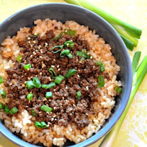 Easy Korean Ground Beef Bowl Recipe and Video - This Korean beef bowl is seasoned with green onions, ginger, soy sauce, and sesame and served over brown rice for a quick and easy dinner.