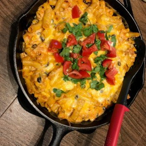 Chicken Fajita Pasta Bake Recipe and Video - This easy chicken fajita pasta bake is made with black beans, corn, and ziti pasta smothered in a tasty sauce made of salsa and cream cheese.