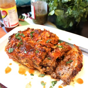 Mexican Taco Meatloaf  Recipe - This taco-seasoned meatloaf is a Mexican-American comfort food everyone will love and want seconds of.
