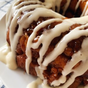 Apple-Walnut Cinnamon Roll Monkey Bread Recipe - Freshly minced apples and toasted walnuts fill the corners of this totally indulgent monkey bread made easy thanks to refrigerated cinnamon roll dough.