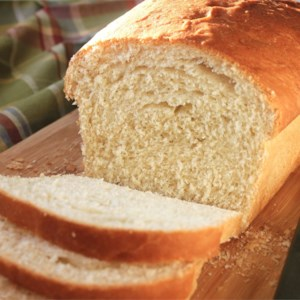 Amish White Bread Recipe and Video - This recipe will give you two loaves of plain, sweet white bread that are quick and easy to make.