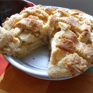 Apple Pie by Grandma Ople Recipe and Video - A unique and popular recipe. Sliced apples under a lattice crust get bathed with a sweet buttery sauce before baking.