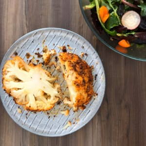 Whole Roasted Cauliflower with Smoked Paprika Recipe - Roasting a whole cauliflower with smoked paprika is an easy, flavorful way to serve a vegetable main dish to any vegetarian or vegan dinner guests.