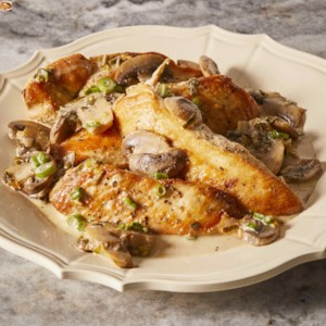 Easy Chicken Marsala Recipe - Chicken breasts are sauteed, then braised in Marsala wine and cream with mushrooms and green onion. Chicken Marsala simplified!