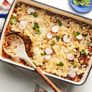 Vegetarian Mexican Casserole Recipe - With some zing from the tomatillos and plenty of crunch from the tortilla chips, this Mexican casserole is a guaranteed hit among your dinner guests.