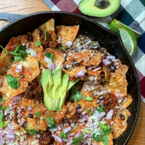 Quick Black Bean Chilaquiles Recipe - Canned black beans and pantry staples combine in this quick and easy, Mexican-inspired chilaquiles dish.