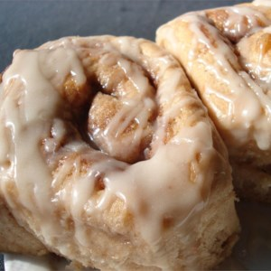 Cake Mix Cinnamon Rolls Recipe - White cake mix is the magic ingredient in these rich cinnamon yeast rolls peppered with pecans on top.