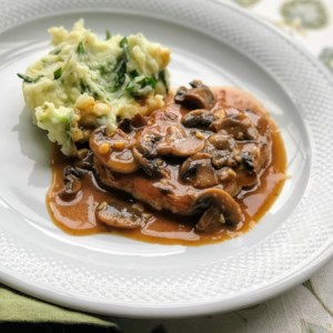 Pork Chops in Garlic Mushroom Sauce Recipe and Video - These boneless pork chops are topped with a garlicky mushroom sauce--a great restaurant-worthy dinner.