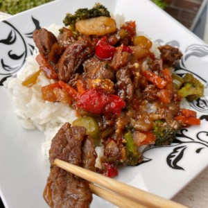 Ginger Beef Stir-Fry Recipe - Skirt steak is stir-fried with vegetables, ginger, and homemade sauce in this quick weeknight recipe.