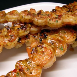 Amazing Spicy Grilled Shrimp Recipe and Video - A blend of olive and sesame oil, hot sauce and chile sauce make this is an amazing spicy grilled shrimp recipe.