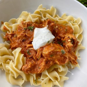 Instant Pot(R) Chicken Paprikash Recipe - Comforting chicken paprikash served over buttered egg noodles will be a hit whether you cook it in an Instant Pot(R) or the stovetop!