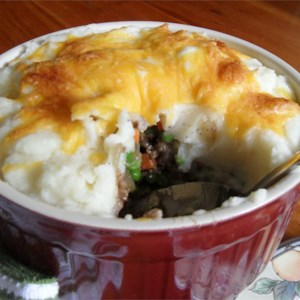 Zippy Shepherd's Pie Recipe - Gather the family round with this quick and easy shepherd's pie recipe. The meat mixture can be made ahead and frozen. You can also substitute instant potatoes for the real thing if you're in a hurry. I especially love to use white cheddar in this recipe!