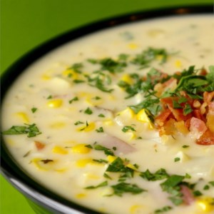 Classic Slow Cooker Corn Chowder Recipe - A comforting and creamy corn chowder with potatoes and ham is made in the slow cooker. Chili powder and hot sauce add a little kick.