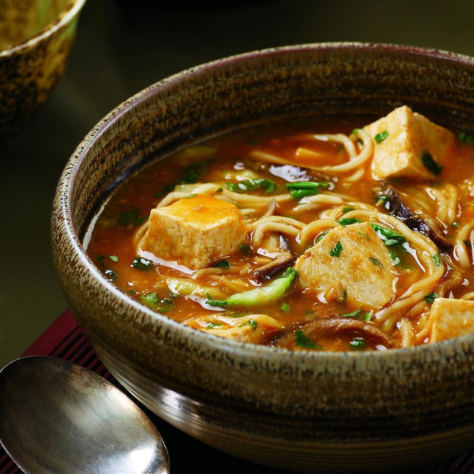 Warm up a chilly evening with this light but satisfying one-pot meal. The tofu absorbs the flavors of this fragrant, spicy broth, making it anything but bland. Look for fresh Chinese-style noodles in the refrigerated case of your supermarket alongside wonton wrappers.