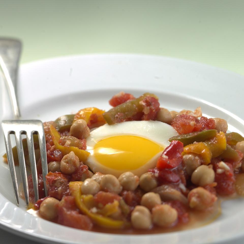 North African Vegetable Stew with Poached Eggs EatingWell Test Kitchen