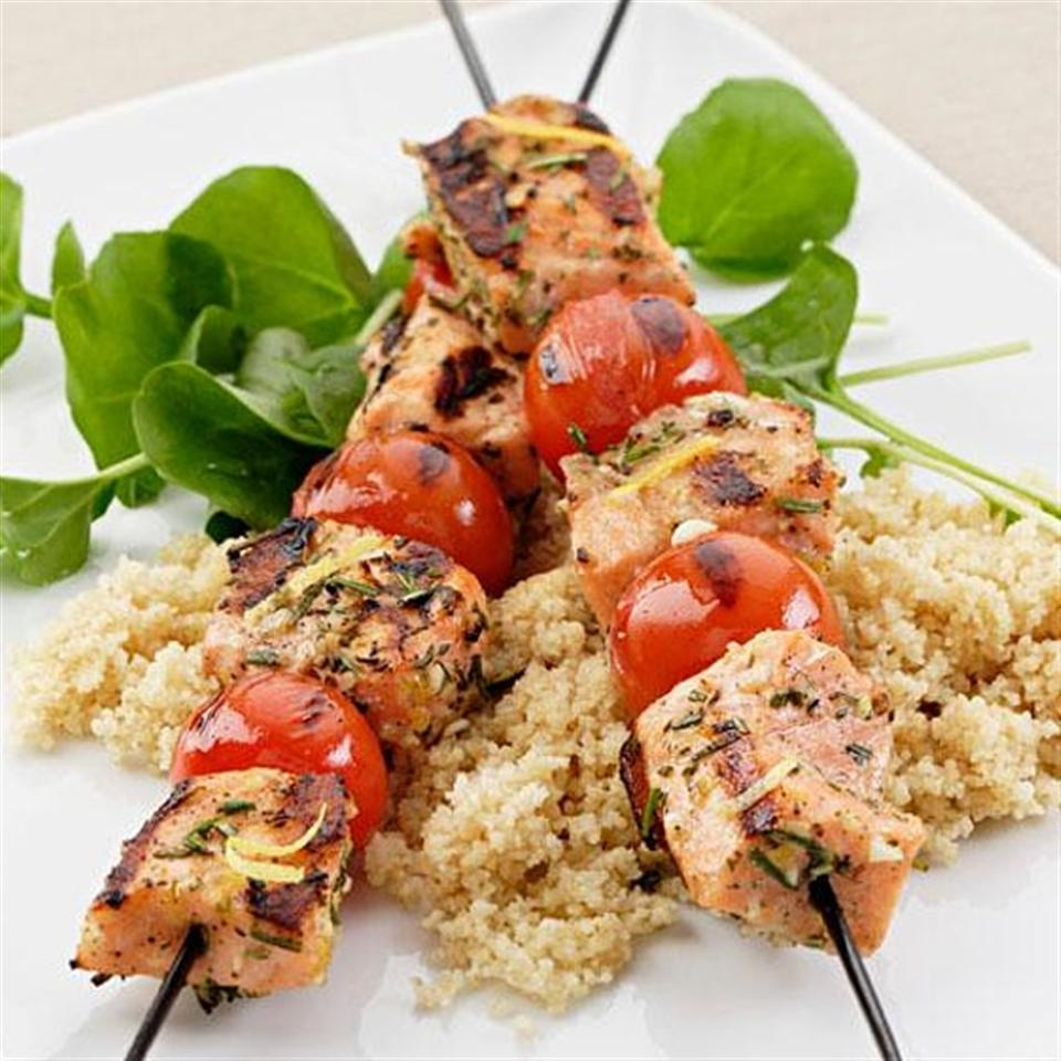 If you can find (or grow) them, use sturdy rosemary branches, stripped of leaves, as skewers for these Italian salmon kebabs; they'll add a subtle, smoky flavor that hints of pine. Oil your grill well to prevent sticking, don't move the kebabs around unnecessarily and keep a close eye on the fire to avoid flare-ups.