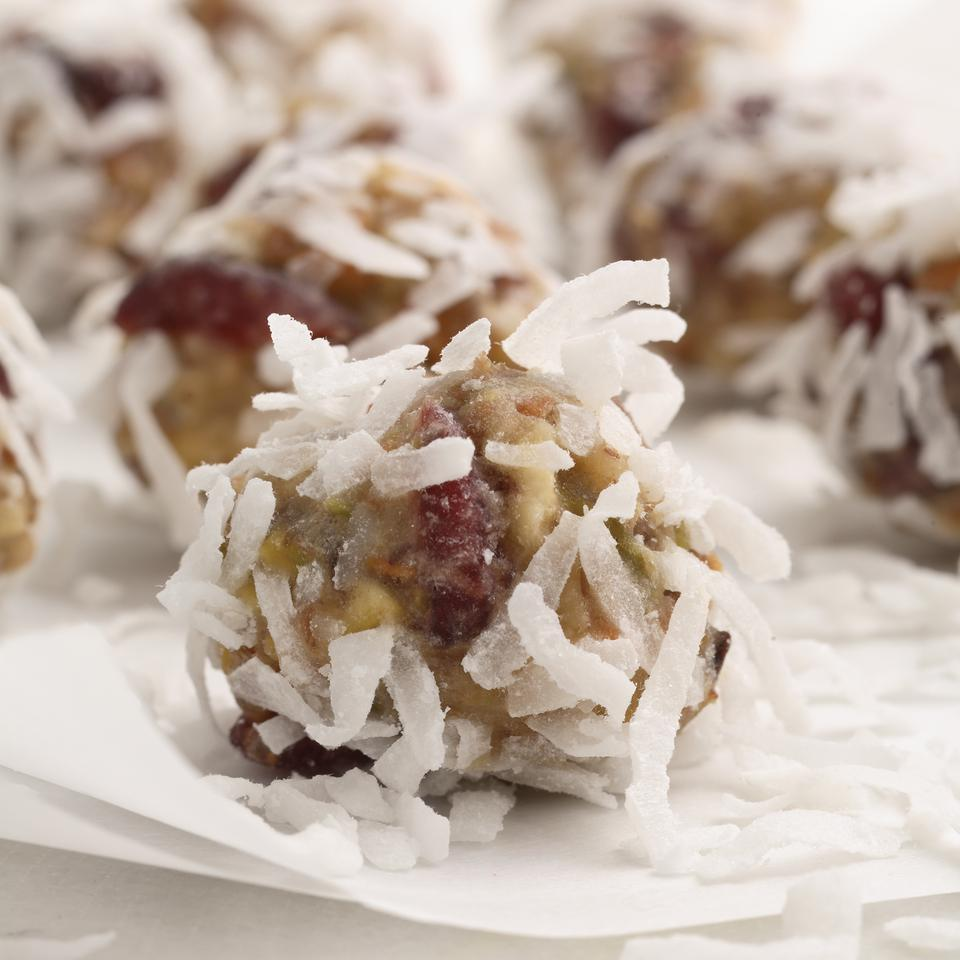 A no-bake, make-ahead treat, this perfect combination of fruit and nuts is a nutritious and delicious mouthful. Rolling them in shredded coconut gives them their festive look.