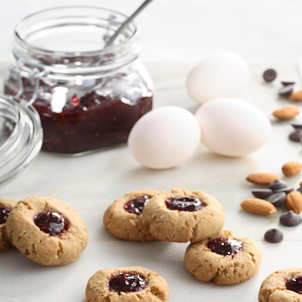 These cookies taste decadent, yet are made with ingredients that have healthful benefits: oats, almonds, fruit and chocolate. The thumbprints are versatile as well—use a different type of filling or different extracts to create a completely different cookie.