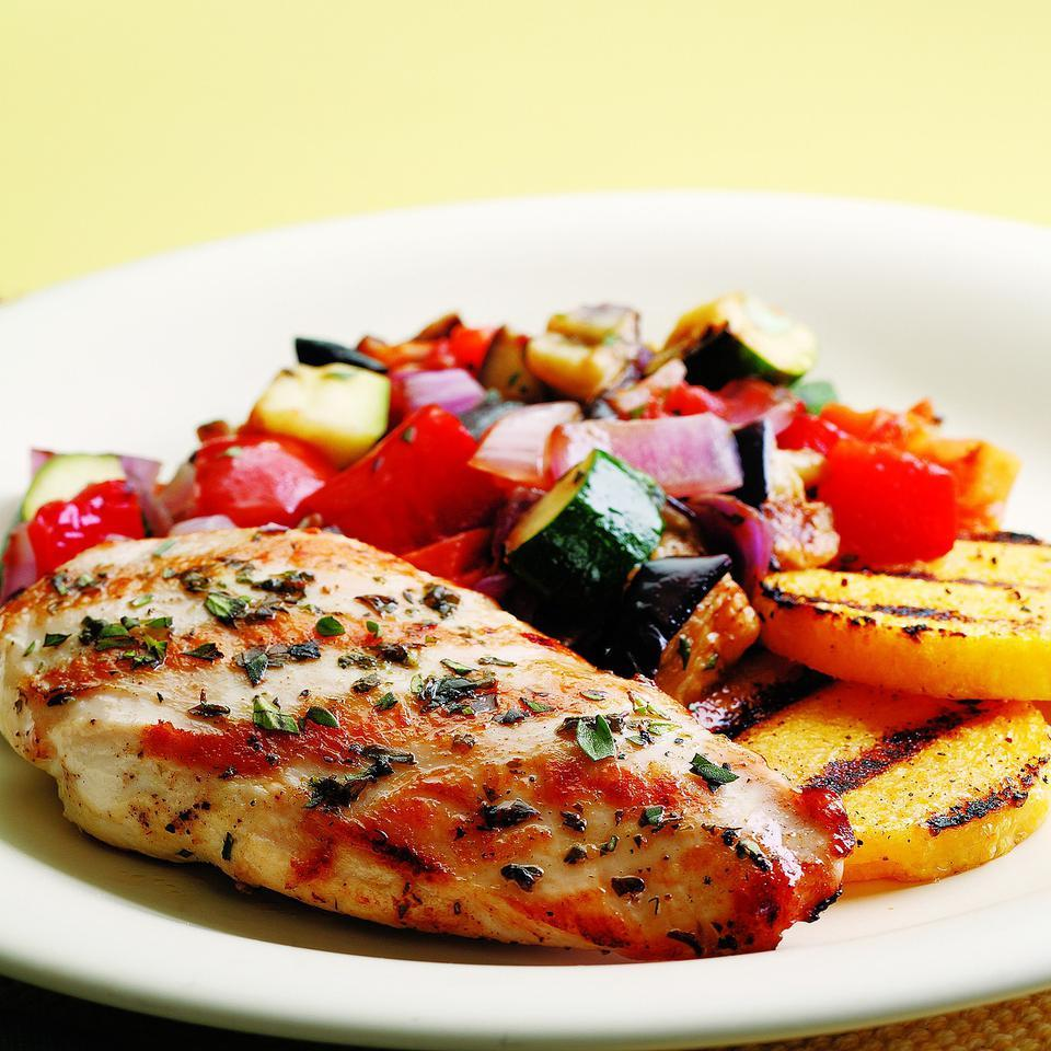 We gave this classic Provençal dish a taste of summer by grilling the vegetables traditionally used in ratatouille (bell pepper, eggplant, zucchini, tomato). Topped with grilled chicken, it makes an easy main course for summer entertaining. We like fresh marjoram and basil to complement the flavors, but any fresh herb will work. Serve with polenta and a glass of Pinot Noir.
